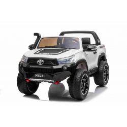 Mașină electrică de jucărie Toyota Hilux 4X4, albă, baterie 2 x 12V / 10 Ah, roți EVA, suspensie de calitate, lumini LED, scaun tapițat, 2.4 GHz DO, cheie, unitate 4X4, dublu, USB, card SD, licență Bluetooth ORGINAL